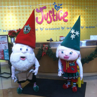 Curtis the elf with employee.