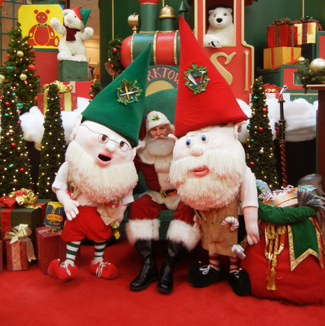 Wally and Victor (Christmas Elves) take a picture with santa clause at Yorktown mall.